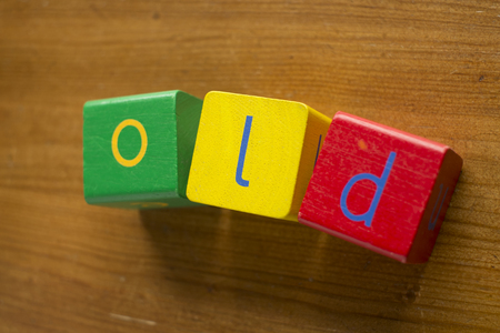 additions: Colorful wooden blocks spelling the word OLD