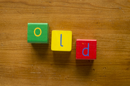 sums: Colorful wooden blocks spelling the word OLD