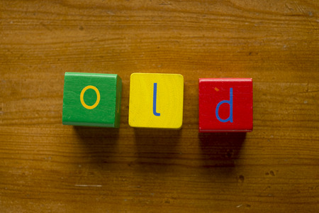 greeen: Colorful wooden blocks spelling the word OLD