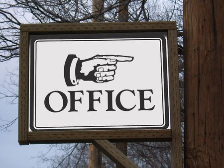 cuffs: Sign with a hand pointing to the office
