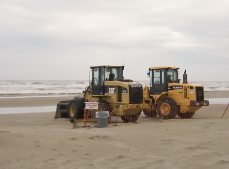 BP continues cleanup of Grand Isle, Louisiana beaches following the Deepwater Horizen oil spill in April