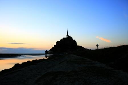 sain: Mont Saint Michel at sunset backlit
