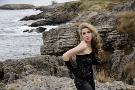 blonde girl with leather pants near the sea Stock Photo - 19940795