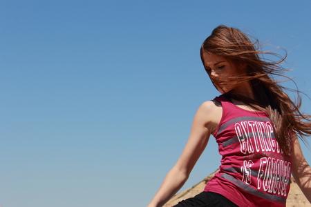 feminity: pretty girl doing yoga in the desert