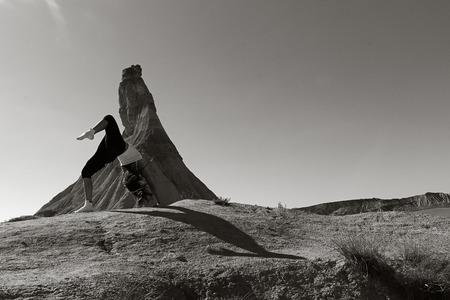sportwoman: pretty girl doing yoga in the desert