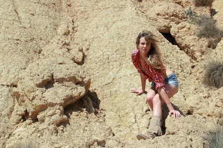 feminity: pretty girl posing in the desert