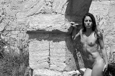 nudist: pretty girl posing in nature Stock Photo