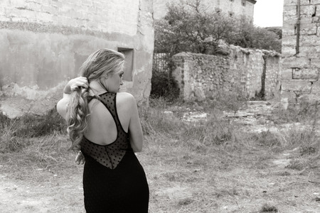 pretty girl posing in ruined town