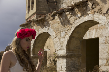 provocative women: pretty girl posing in ruined town