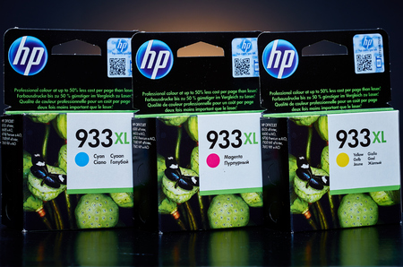 hp: Umag, Croatia - 28 October 2015: Packet of Hewlett Packard 933XL Cyan, Magenta and Yellow ink for a ink jet printer