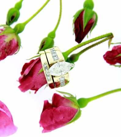 Diamond wedding ring with red roses isolated on white Stock Photo