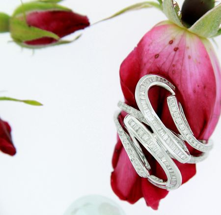 Diamond right hand ring with red roses isolated on white Stock Photo
