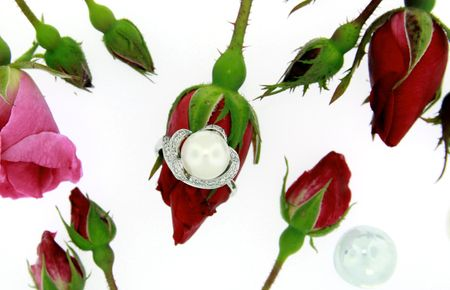 Pearl ring with red roses isolated on white