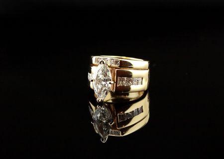 diamond wedding ring closeup reflecting on black background