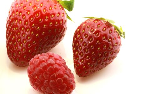 closeup of fresh strawberries and raspberry isolated on white Stock Photo