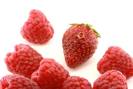 closeup of fresh strawberry and raspberries isolated on white