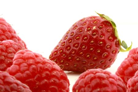 closeup of fresh raspberries and strawberry isolated on white Stock Photo