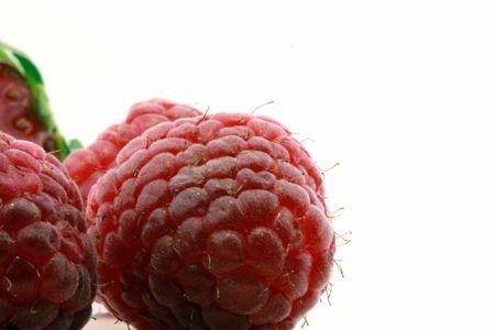 closeup of fresh raspberries isolated on white