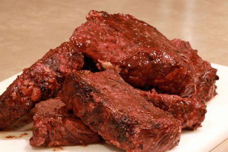 boneless barbecue ribs on cutting board