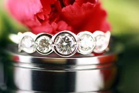 wedding rings with red carnation