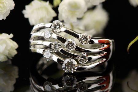unique diamond ring reflecting on background Stockfoto