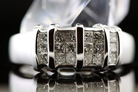 diamond wedding ring reflecting on background