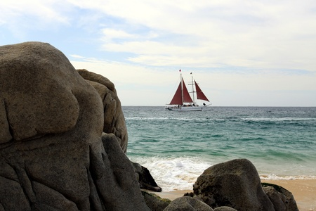 rock formation: Rock formation with sailboat in Cabo San Lucas, Mexico Stock Photo