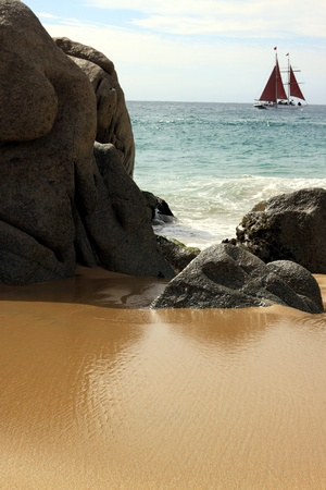 Rock formation with sailboat in Cabo San Lucas, Mexico photo