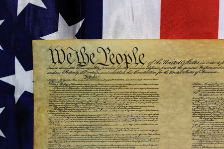 judgement day: Historical Document US Constitution - We The People with American Flag Stock Photo