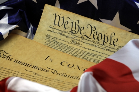 Historical Document US Constitution - We The People with American Flag Stock Photo