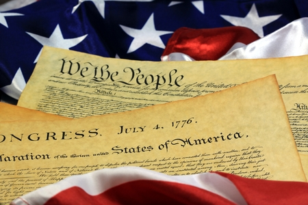 Historical Document US Constitution - We The People with American Flag Stockfoto
