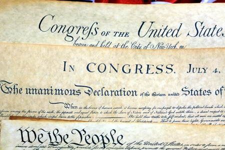 we the people: Historical Document US Constitution - We The People with American Flag Stock Photo