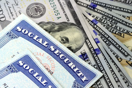 Social security card and US currency one hundred dollar bill
