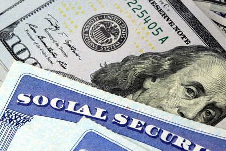 Social security card and US currency one hundred dollar bill Retirement Concept Social Security Benefits 스톡 콘텐츠