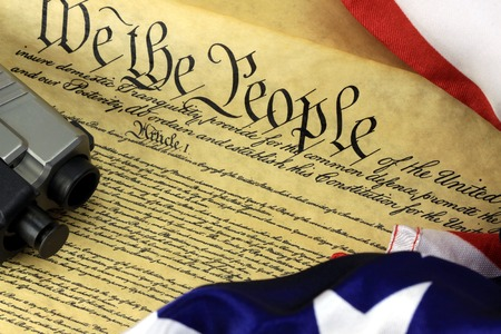 US Constitution with Hand Gun - Right To Keep and Bear Arms Stock Photo