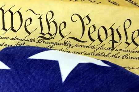 preamble: Historical Document US Constitution - We The People with American Flag Stock Photo