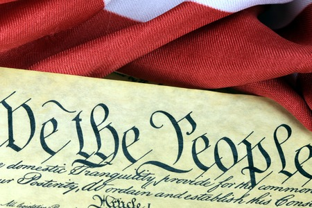 amendment: Historical Document US Constitution - We The People with American Flag Stock Photo