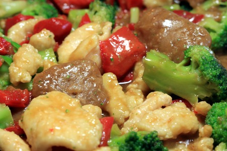 stir fry: Stir fry with beef, chicken and vegetables Stock Photo
