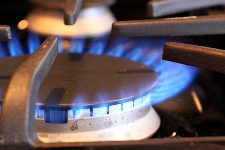 Natural gas stove burner with blue flame Stok Fotoğraf