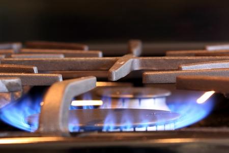 天然ガスは青い炎でバーナーをストーブ 写真素材