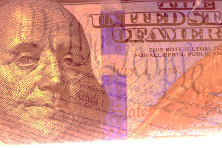 one hundred dollar bill: Double exposure US constitution We the People and one hundred dollar bill Stock Photo