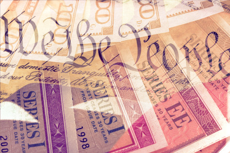 us constitution: Double exposure US constitution We the People, American flag and treasury savings bond - Finance and government concept