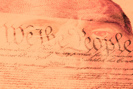 one hundred dollar bill: Double exposure US constitution We the People and one hundred dollar bill - Finance and government concept