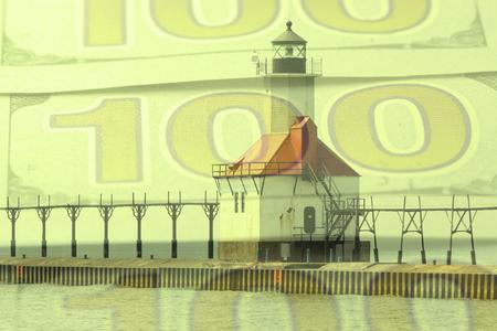 lake michigan lighthouse: Double exposure St. Joseph north pier lighthouse along shoreline of Lake Michigan with hundred dollar bill background