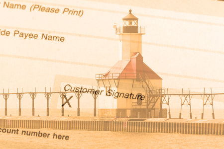 lake michigan lighthouse: Double exposure St. Joseph north pier lighthouse along shoreline of Lake Michigan