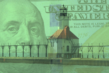 lake michigan lighthouse: Double exposure St. Joseph north pier lighthouse along shoreline of Lake Michigan with hundred dollar bill background