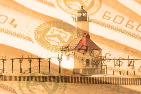 lake michigan lighthouse: Double exposure St. Joseph north pier lighthouse along shoreline of Lake Michigan with treasury savings bond background