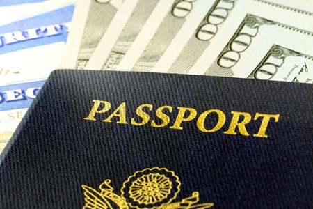 United States passport with one hundred dollar bills