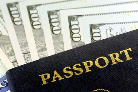 Travel Documents - USA Passport with American Currency Stockfoto