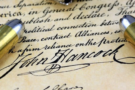 casings: Ammunition on US Constitution John Hancocks signature  - The Right to Bear Arms